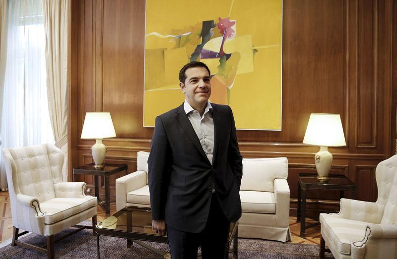 Greek PM Tsipras stands at his office before a meeting with leader of the centre-left To Potami party Theodorakis in Maximos Mansion in Athens