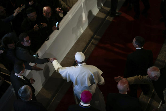 Pope Francis arrives for a meeting with Catholic priests and other Christian representatives in the cathedral of the capital, Rabat, Morocco, Sunday, March 31, 2019. Pope Francis is in Morocco for a two-day trip aimed at highlighting the North African nation's Christian-Muslim ties, while also showing solidarity with migrants at Europe's door and tending to a tiny Catholic flock. (AP Photo/Mosa'ab Elshamy)
