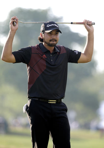 Jason Day, of Australia, reacts after a putt on the 18th hole during the fourth round of the U.S. Open golf tournament at Merion Golf Club, Sunday, June 16, 2013, in Ardmore, Pa. (AP Photo/Morry Gash)