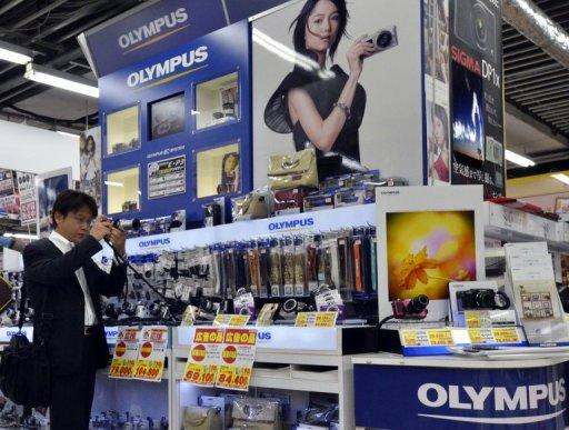 Olympus' re-stated financial statements showed it lost 33.08 billion yen in the nine months to December