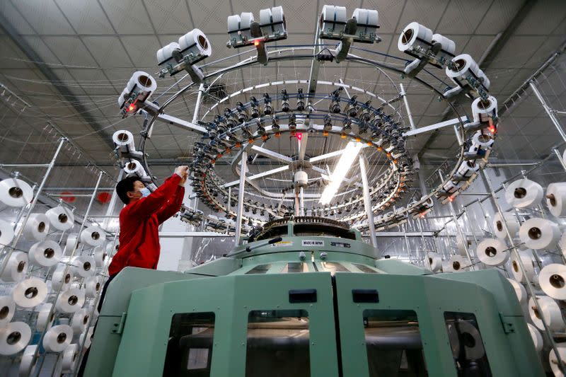 China factory activity shows minimal growth in March after plunge, still in virus grip