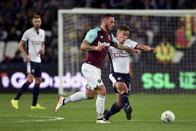 West Ham United's Marko Arnautovic, left, and Bolton Wanderers' Jeff King battle for the ball during their English League Cup, third round soccer match at the London Stadium in London, Tuesday, Sept. 19, 2017. (Daniel Hambury/PA via AP)