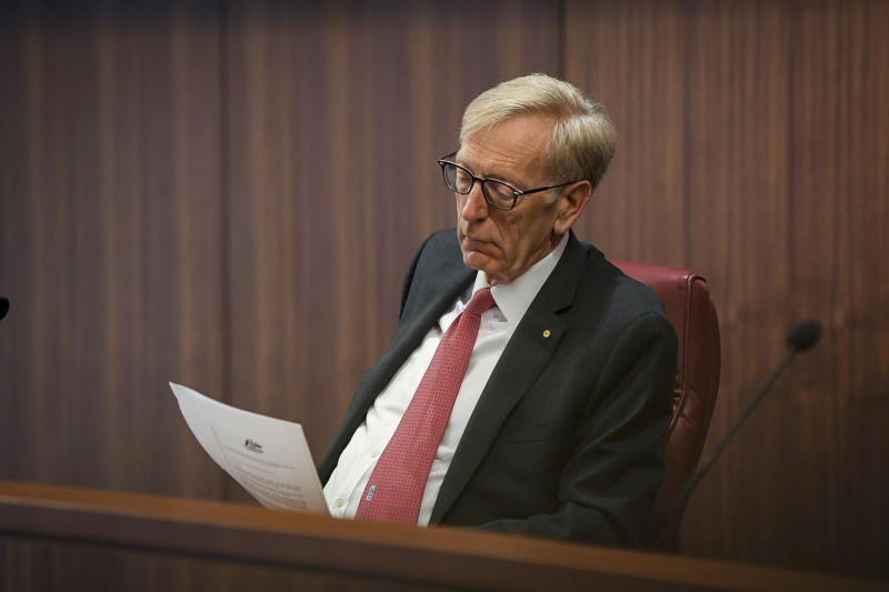 Banking Royal Commissioner Kenneth Hayne contemplates a document.