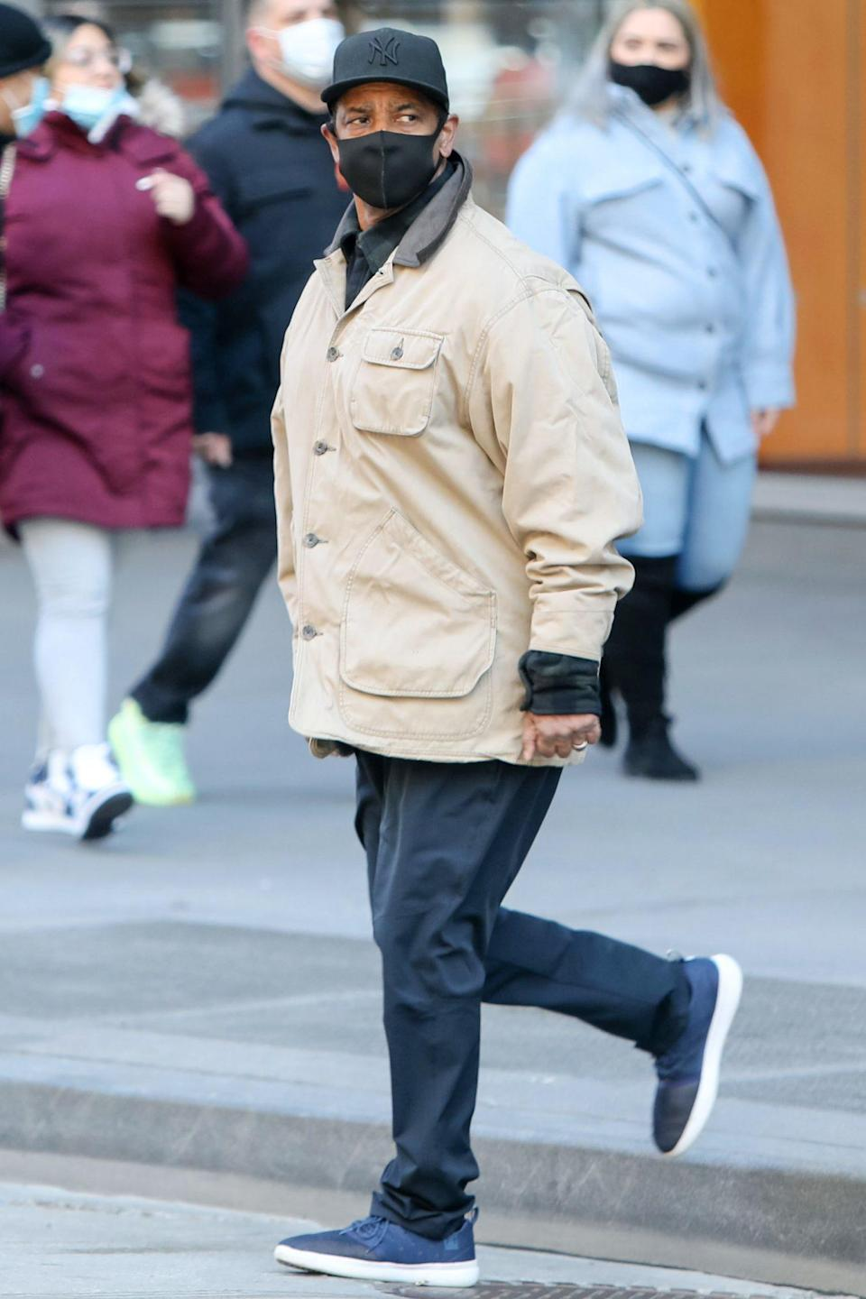 <p>Denzel Washington is seen on the set of his latest project <em>A Journal for Jordan</em> on Sunday in N.Y.C.'s Times Square.</p>