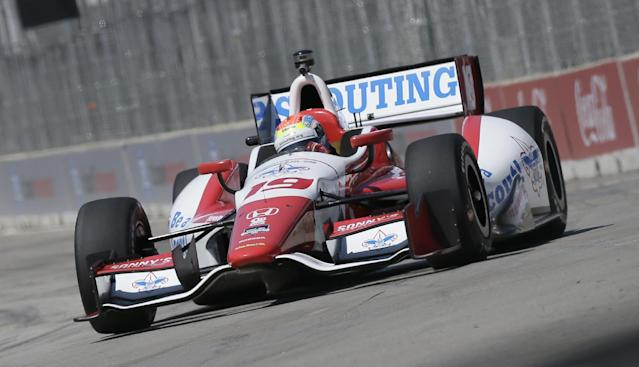 Driver Justin Wilson takes the first turn during a practice session for the IndyCar Detroit Grand Prix auto race on Belle Isle in Detroit, Friday, May 30, 2014. (AP Photo/Carlos Osorio)