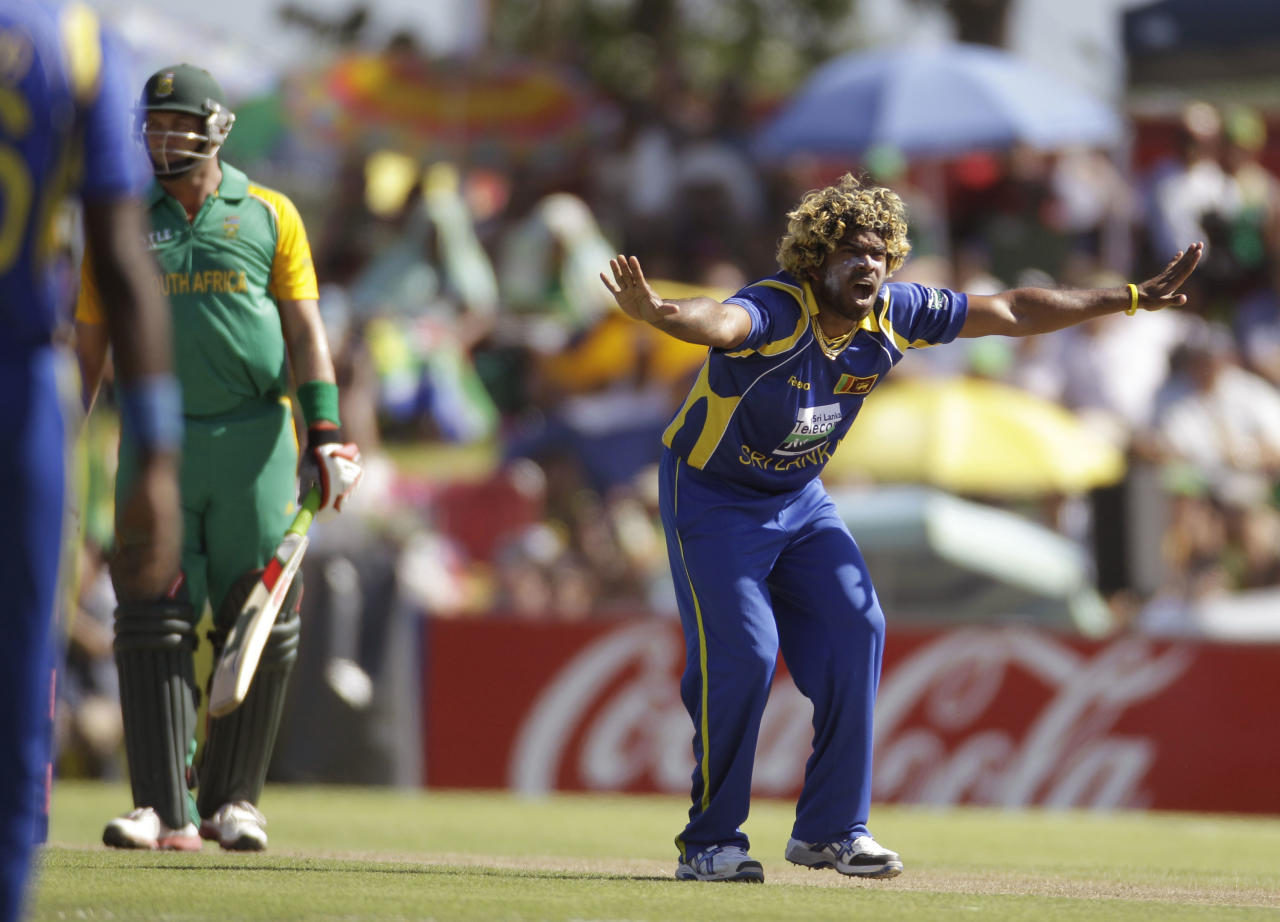 Sri Lanka cricketer Lasith Malinga, right, reacts during the first one day international against South African held in Paarl, South Africa, Wednesday, Jan 11, 2012. (AP Photo/Schalk van Zuydam)