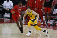 Iowa's Connor McCaffery, right, drives to the basket as Ohio State's E.J. Liddell defends during the first half of an NCAA college basketball game Sunday, Feb. 28, 2021, in Columbus, Ohio. (AP Photo/Jay LaPrete)