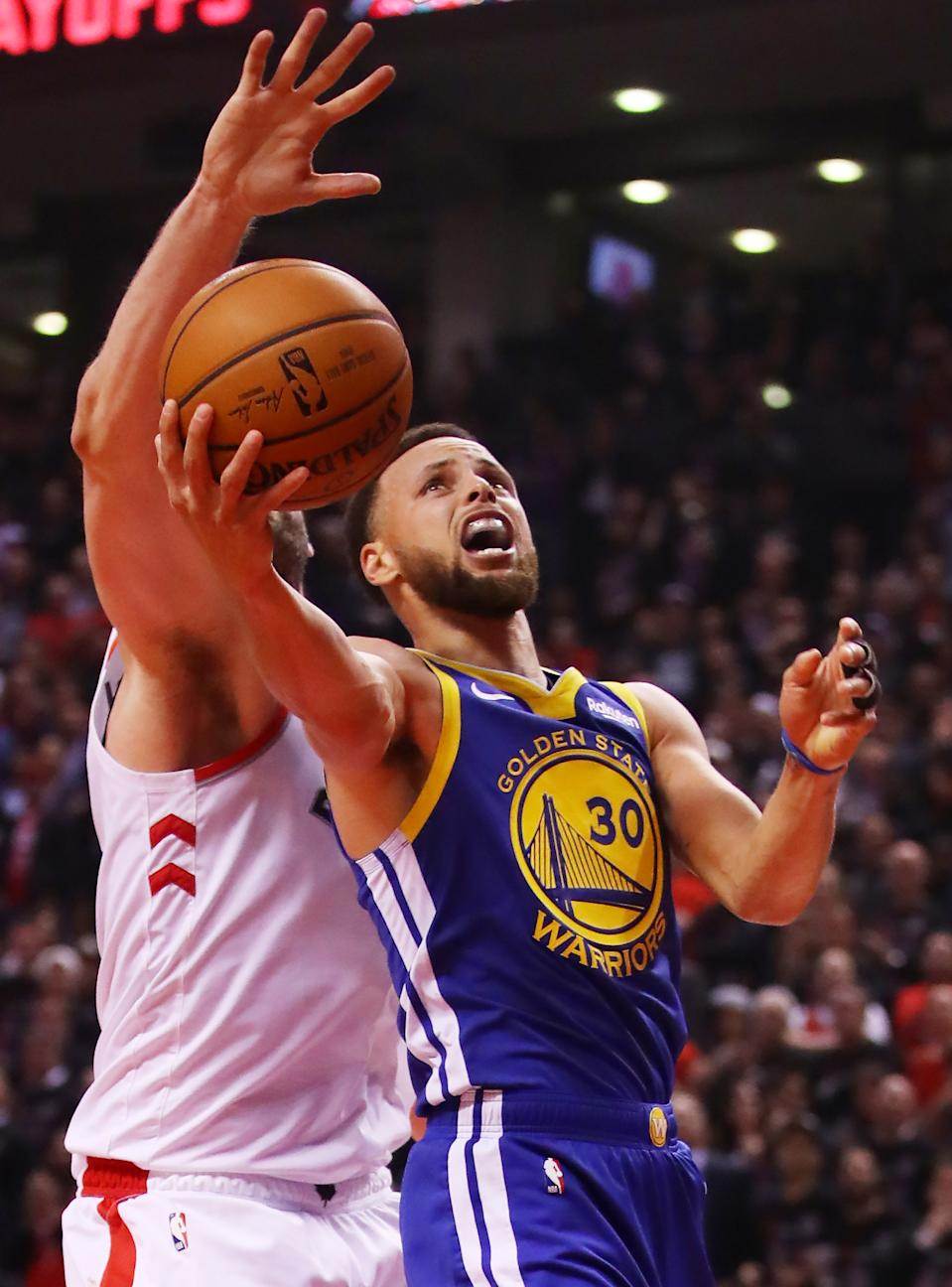Stephen Curry #30 of the Golden State Warriors attempts a shot against the Toronto Raptors in the second quarter during Game One of the 2019 NBA Finals at Scotiabank Arena on May 30, 2019 in Toronto, Canada. (Photo by Gregory Shamus/Getty Images)
