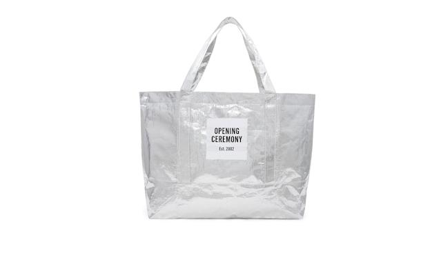 "<p>Large metallic silver tote bag, $35,<a href=""https://www.openingceremony.com/mens/opening-ceremony/large-silver-chinatown-tote-bag-ST199969.html"" rel=""nofollow noopener"" target=""_blank"" data-ylk=""slk:openingceremony.com"" class=""link rapid-noclick-resp""> openingceremony.com</a> </p>"