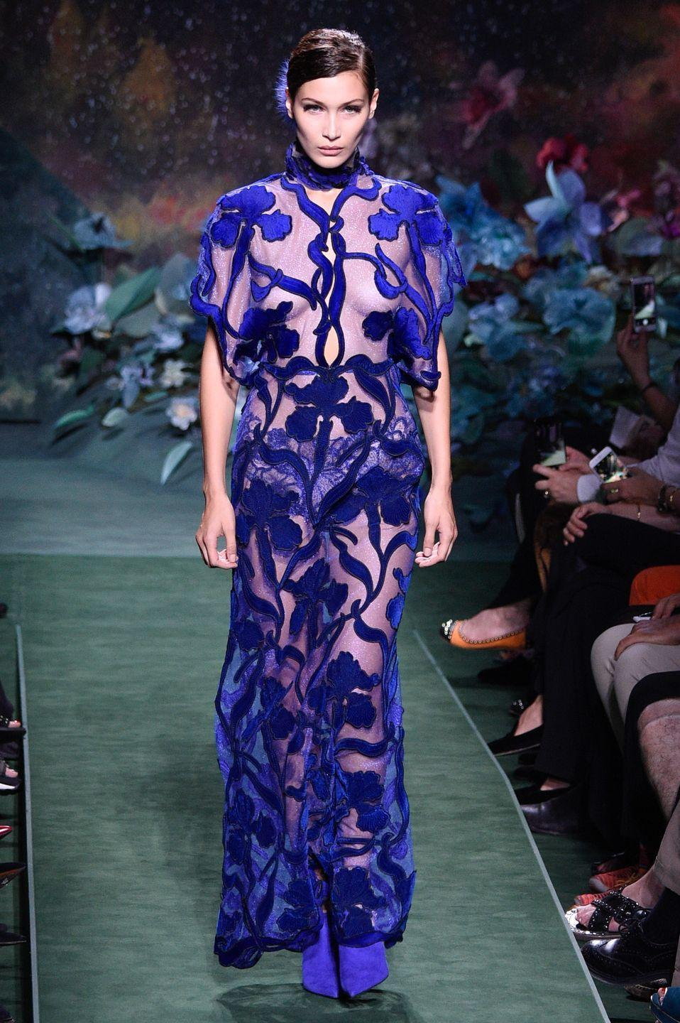 <p>Bella Hadid walks in the Fendi Haute Couture show wearing a sheer blue gown, 5 July 2017</p>