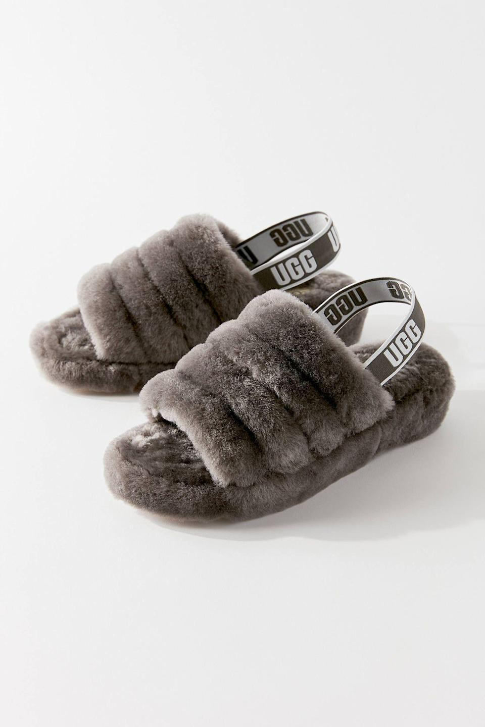 """<p><strong>Ugg</strong></p><p>amazon.com</p><p><a href=""""https://www.amazon.com/dp/B078VDKGKR?tag=syn-yahoo-20&ascsubtag=%5Bartid%7C10049.g.35017315%5Bsrc%7Cyahoo-us"""" rel=""""nofollow noopener"""" target=""""_blank"""" data-ylk=""""slk:Shop Now"""" class=""""link rapid-noclick-resp"""">Shop Now</a></p><p>Your feet will absolutely melt in these UGG slippers that have become *the* footwear of quarantine. </p>"""