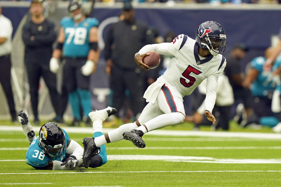 Houston Texans quarterback Tyrod Taylor (5) breaks away from Jacksonville Jaguars safety Andre Cisco (38) during the second half of an NFL football game Sunday, Sept. 12, 2021, in Houston. (AP Photo/Eric Christian Smith)