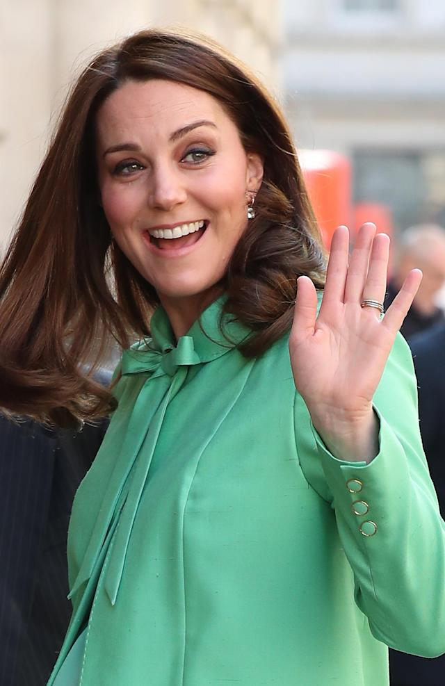 The Duchess wore a bespoke Jenny Packham coat, with a bow necktie, and accessorized with earrings she's worn before. (Photo: Getty)