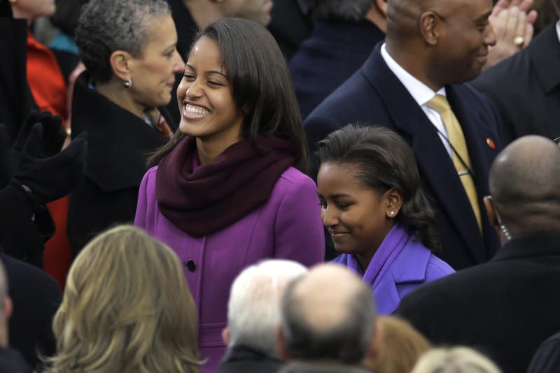Malia Obama and Sasha Obama arrive at the ceremonial swearing-in for President Barack Obama at the U.S. Capitol during the 57th Presidential Inauguration in Washington, Monday, Jan. 21, 2013. (AP Photo/Carolyn Kaster)