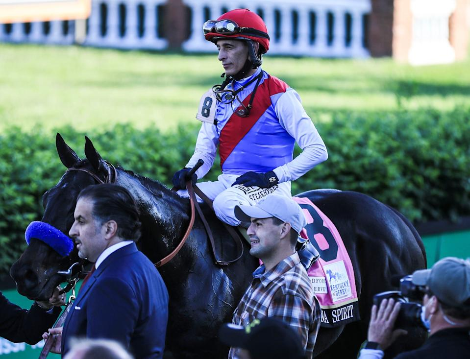 Medina Spirit with jockey John Velazquez head to the Winner's Circle at Churchill Downs after winning the 147th Kentucky Derby. At bottom left is owner Amr Zedan. May 1, 2021