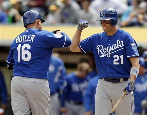 Kansas City Royals' Billy Butler (16) celebrates his solo home run with teammate Jeff Francoeur (21) during the fourth inning of a baseball game against the Oakland Athletics, Wednesday, April 11, 2012, in Oakland, Calif. (AP Photo/Marcio Jose Sanchez)