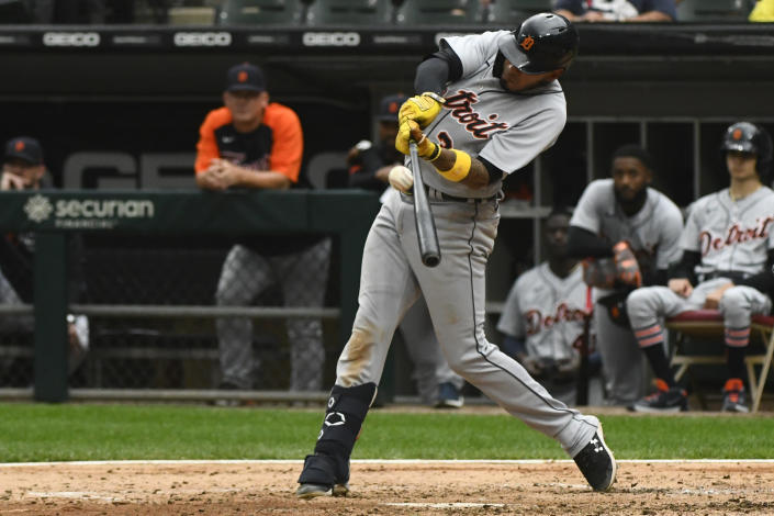 Detroit Tigers' Harold Castro hits a sacrifice fly RBI during the fifth inning of a baseball game against the Chicago White Sox, Sunday, Oct. 3, 2021, in Chicago. (AP Photo/Matt Marton)