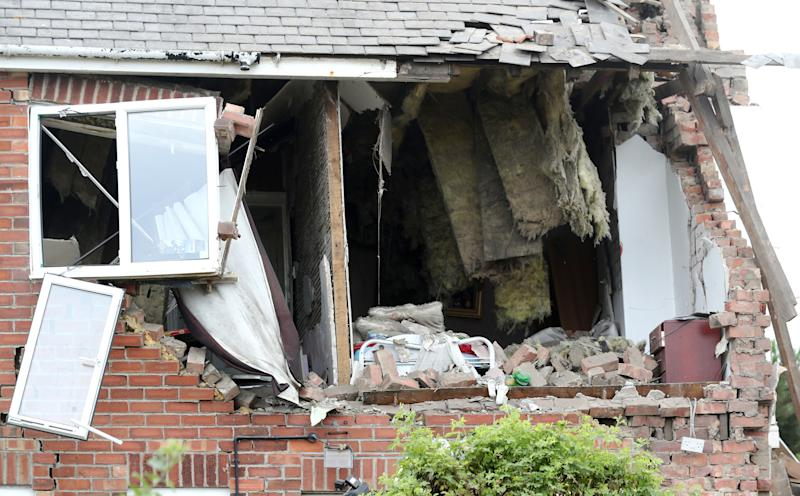 <strong>Damage caused to a neighbouring property by the blast</strong> (PA Wire/PA Images)