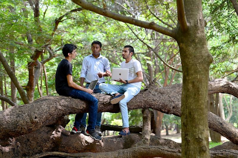 """Ethical hackers"" Anand Prakash (R), Shashank (L), and Rohit Raj (C), who break into computer networks to expose rather than exploit weaknesses, meet at a public park in Bangalore (AFP Photo/MANJUNATH KIRAN)"