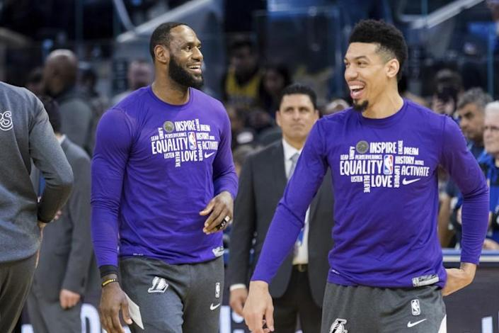 """Lakers forward LeBron James, left, and guard Danny Green take part in warmups before a game against the Warriors on Feb. 8. <span class=""""copyright"""">(John Hefti / Associated Press)</span>"""