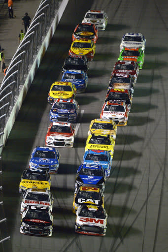 Austin Dillon (3) and Greg Biffle (16) lead the field to the green flag for the start of the first of two NASCAR Sprint Cup qualifying auto races at Daytona International Speedway in Daytona Beach, Fla., Thursday, Feb. 20, 2014. (AP Photo/Phelan M. Ebenhack)