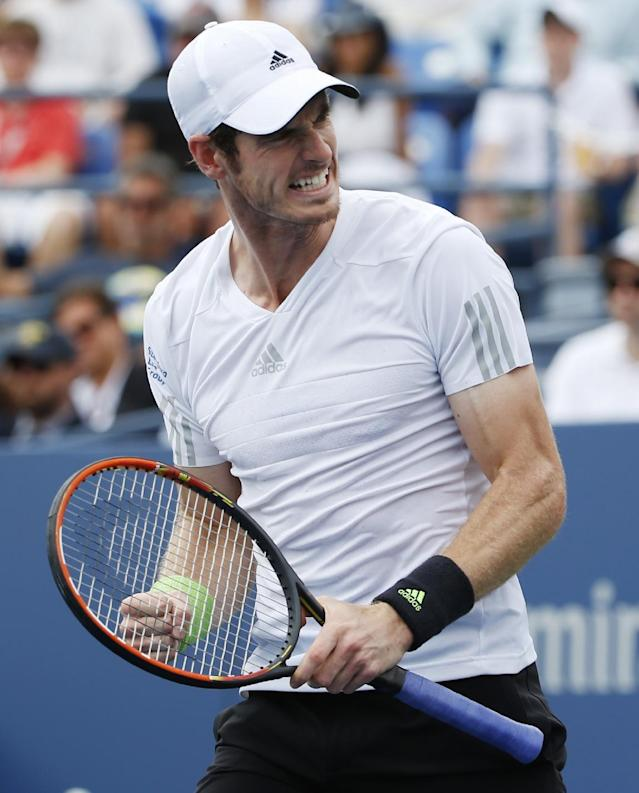 Andy Murray, of the United Kingdom, reacts after a shot against Andrey Kuznetsov, of Russia, during the third round of the 2014 U.S. Open tennis tournament, Saturday, Aug. 30, 2014, in New York. (AP Photo/Kathy Willens)