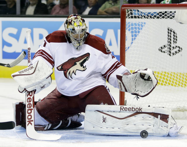 Phoenix Coyotes goalie Mike Smith stops a shot attempt against the San Jose Sharks during the first period of an NHL hockey game on Saturday, Nov. 2, 2013, in San Jose, Calif. (AP Photo/Marcio Jose Sanchez)