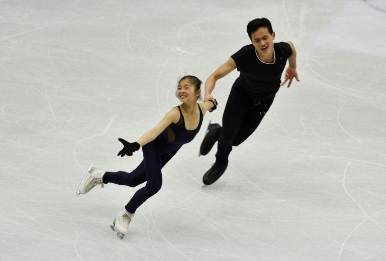 Ryom Tae-Ok (L) and Kim Ju-Sik (R) of North Korea attend a practice session in Taipei