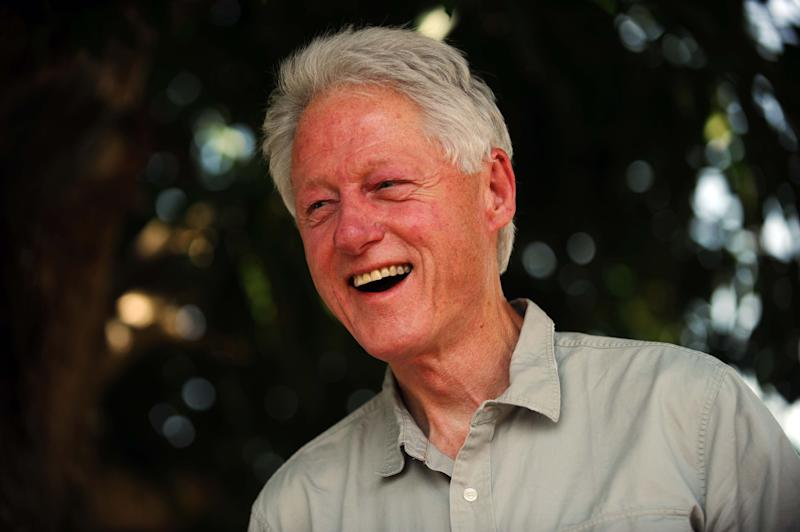 Former US president Bill Clinton smiles as he visits a peanut plantation in Tierra Muscady, in the central plateau of Haiti, on June 29, 2014