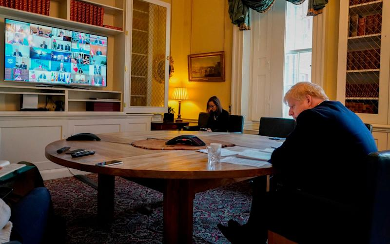 Boris Johnson participating in a video conference call with other G20 leaders in the study of 10 Downing Street in central London on March 26, 2020.  - ANDREW PARSONS /AFP