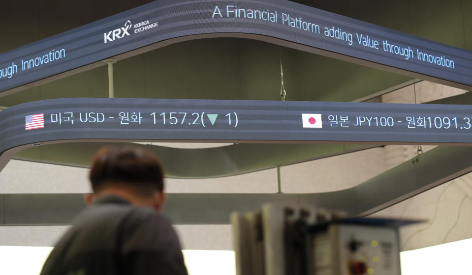 A man stands near a screen showing the foreign exchange rates at the Korea Exchange in Seoul, South Korea, Thursday, Oct. 8, 2020. Asian shares were mostly higher Thursday on optimism that U.S. stimulus may be coming, as President Donald Trump appeared to reverse his earlier decision to halt talks on another economic rescue effort. (AP Photo/Lee Jin-man)