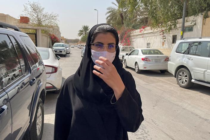 Saudi activist Loujain Al-Hathloul makes her way to appear at a special criminal court for an appeals hearing, in Riyadh, Saudi Arabia March 10, 2021. (Ahmed Yosri/Reuters)