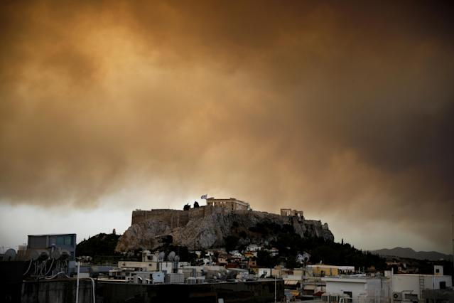 <p>Smoke from a wildfire burning outside Athens is seen over the Parthenon temple atop the Acropolis hill in Athens, Greece, July 23, 2018. (Photo: Alkis Konstantinidis/Reuters) </p>