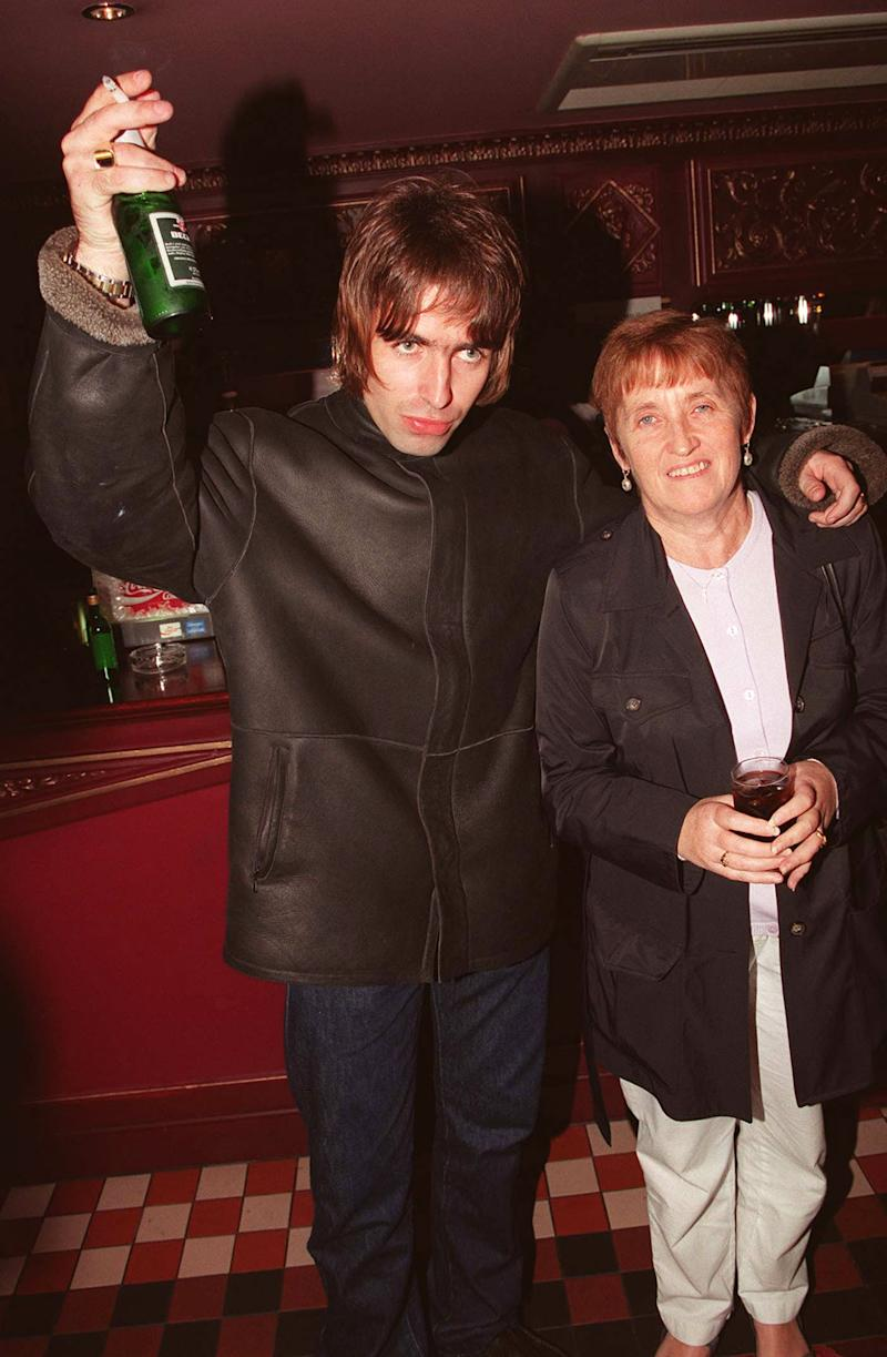LONDON - 1995: Oasis lead singer Liam Gallagher with is mother Peggy Gallagher at the opening night of Steve Coogan's comedy show in the West End, London. (Photo by Dave Hogan/Getty Images)