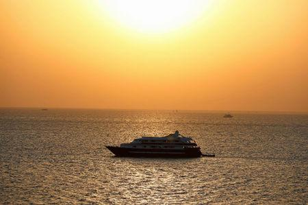 A ferry travels on the sea as the sun rises in Hurghada, Egypt, July 15, 2017. REUTERS/Mohamed Abd El Ghany