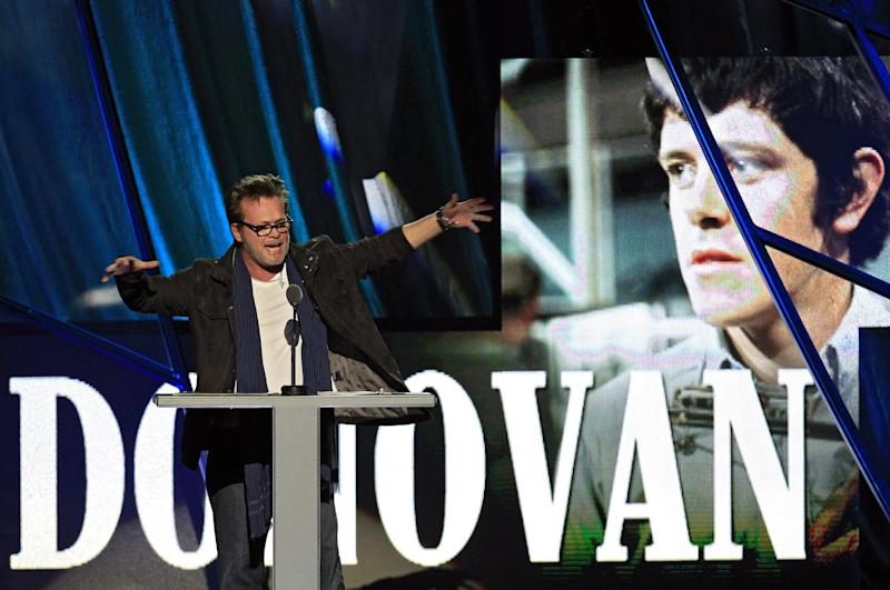 John Mellencamp introduces Donovan Leitch for induction into the Rock and Roll Hall of Fame Saturday, April 14, 2012, in Cleveland. (AP Photo/Tony Dejak)