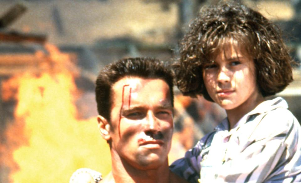 Schwarzenegger and Alyssa Milano in 'Commando' (Photo: 20th Century Fox Film Corp./Courtesy Everett Collection)