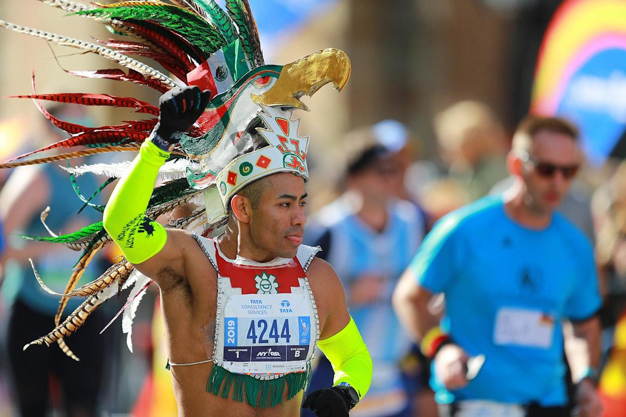 A runner in costume makes his way north on First Avenue during the New York City Marathon. (Photo: Gordon Donovan/Yahoo News)