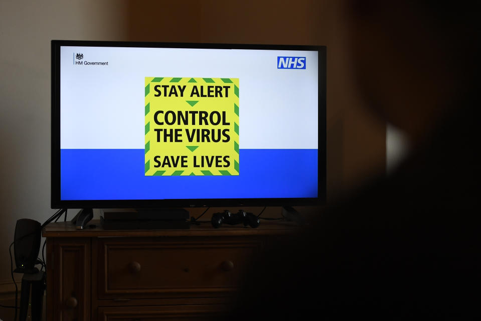 "BRADFORD, ENGLAND  - MAY 10: The government's new slogan ""Stay Alert, Control the Virus, Save Lives"" is seen during Britain's Prime Minister Boris Johnson's televised message to the nation on May 10, 2020 in Bradford, England. The UK is continuing with quarantine measures intended to curb the spread of Covid-19, but as the infection rate is falling government officials are discussing the terms under which it would ease the lockdown. (Photo by George Wood/Getty Images)"