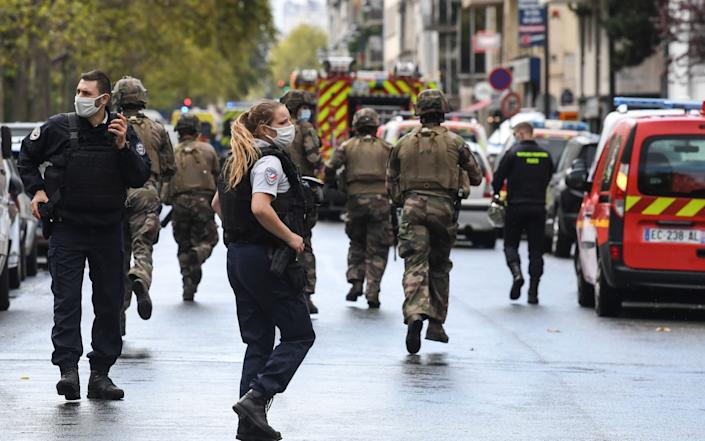 French soldiers were seen rushing towards the scene of the attack - ALAIN JOCARD /AFP