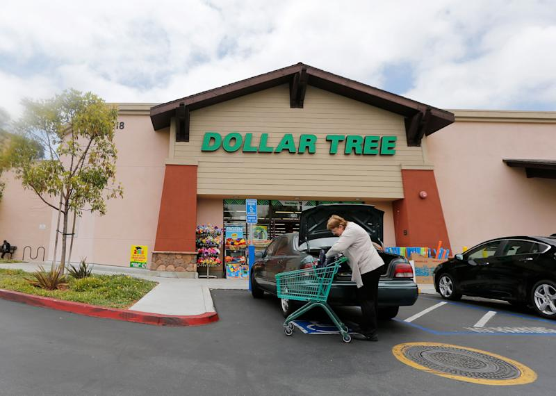 FILE - In this May 26, 2016, file photo, a shopper searches her purse outside a Dollar Tree store in Encinitas, Calif. Dollar Tree, Inc. reports financial results Thursday, May 30, 2019. (AP Photo/Lenny Ignelzi, File)