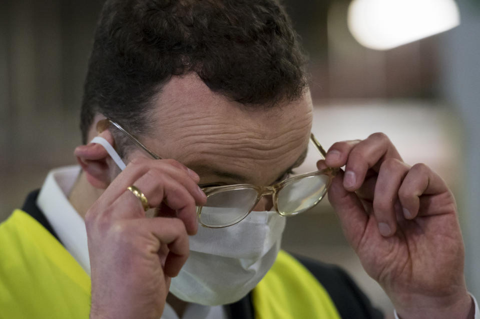 APFELSTAEDT, GERMANY - APRIL 03: German Federal Health Minister Jens Spahn's glasses start to steam up as he wears a protective mask at a warehouse on April 3, 2020 in Apfelstaedt, Germany. Germany is struggling to supply its health workers with sufficient numbers of protective suits, masks, goggles and other equipment they need in the race to treat the growing number of patients sickened with Covid-19, the disease caused by the coronavirus. Germany has so far registered approximately 85,000 cases of Covid-19 infection and 1,123 people have died. (Photo by Jens-Ulrich Koch/Getty Images)