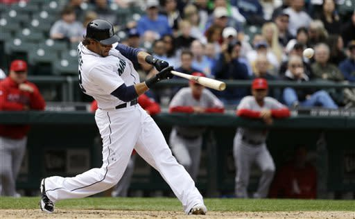 Seattle Mariners' Michael Morse hits a home run against the Los Angeles Angels in the eighth inning of a baseball game, Sunday, April 28, 2013, in Seattle. (AP Photo/Elaine Thompson)