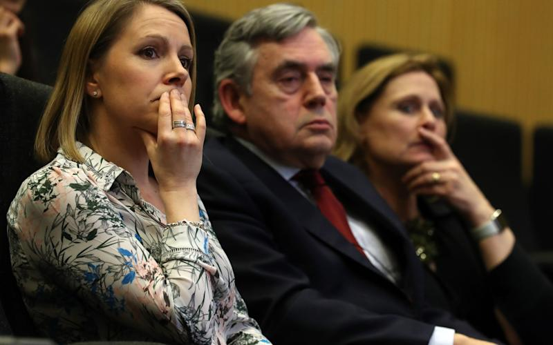 Catherine Smith sits with former prime minister Gordon Brown and his wife Sarah - Credit: PA/Andrew Milligan