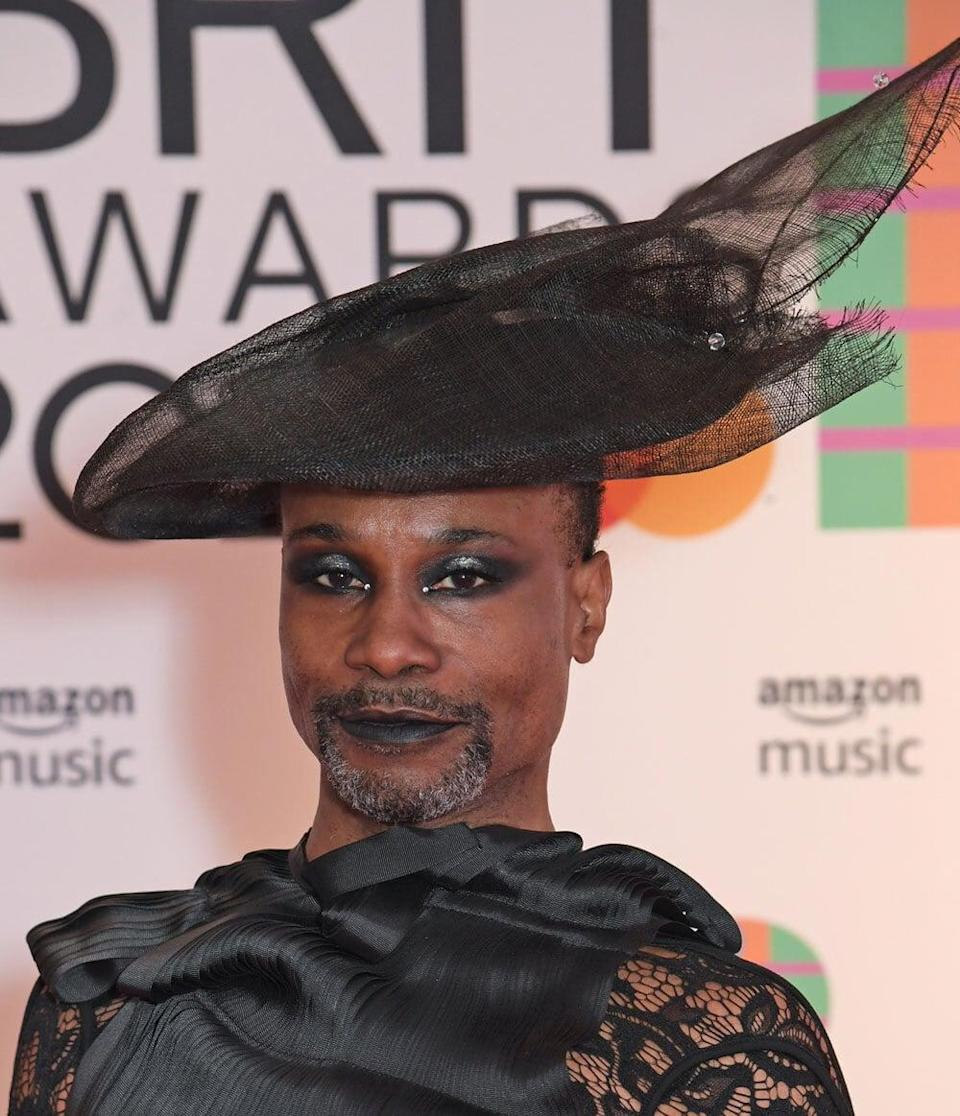 <p>We can't get over Porter's epic all-black ensemble and beauty look on the red carpet, which featured a matte black lip and a diffused black smoky eye with a shimmery silver center, topped off with tiny crystals on the inner corners of his eyes.</p>