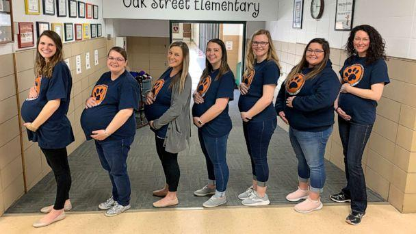PHOTO: The seven pregnant teachers pose in their due date order in the front hall at Oak Street Elementary in Goddard, Kan. (USD 265 Goddard Public Schools)