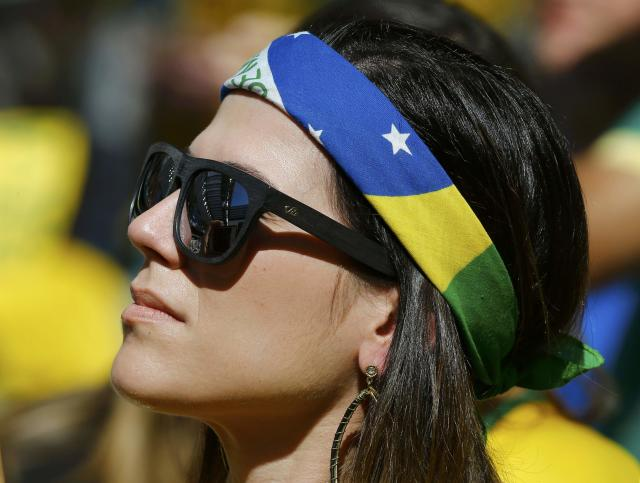 A fan waits for the 2014 World Cup Group B soccer match between Australia and Spain at the Baixada arena in Curitiba June 23, 2014. REUTERS/Stefano Rellandini (BRAZIL - Tags: SOCCER SPORT WORLD CUP)