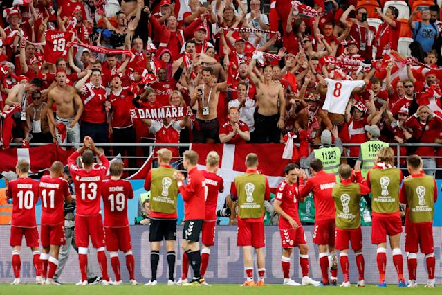 Soccer Football - World Cup - Group C - Peru vs Denmark - Mordovia Arena, Saransk, Russia - June 16, 2018 Denmark fans celebrate victory as the players applaud after the match REUTERS/Carlos Garcia Rawlins TPX IMAGES OF THE DAY