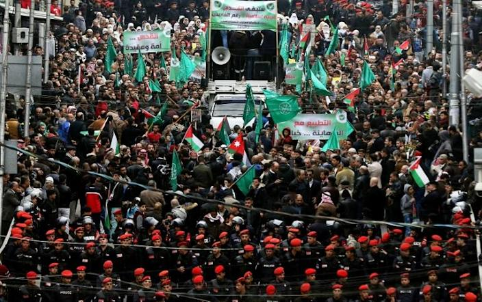 """The Muslim Brotherhood is a pan-Islamic movement with both charitable and political arms. It has faced years of pressure since the 2011 Arab Spring uprisings and has been outlawed as a """"terrorist"""" group in several countries (AFP Photo/Khalil MAZRAAWI)"""