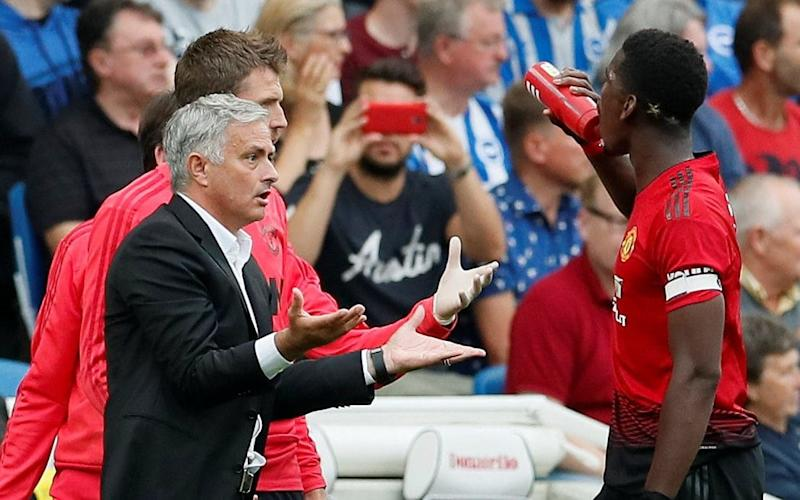 Asking questions: Jose Mourinho and Paul Pogba - REUTERS